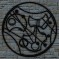 """Gallifreyan. It says, """"Moriarty was real."""" This might just be one of the coolest things I've ever seen. Fantastic."""