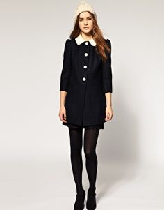 Black and white Peter Pan collar coat. Adorable!