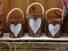 How to Make Rusty Tin Can Lanterns DIY - - Fill tin cans with water, put them in the freezer, and you are SO going to want this to brighten up your backyard! Tin Can Lanterns, How To Make Lanterns, Star Lanterns, Tin Can Crafts, Arts And Crafts, Diy Crafts, Crafts With Tin Cans, Soup Can Crafts, Tin Can Art