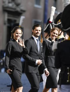Sofia, Carl Philip and Madeleine wave to crowds as they mark the opening of…