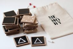 Handmade memory game. The cards are painted with chalkboard paint, so the players are able to draw their own favourite images on them before playing