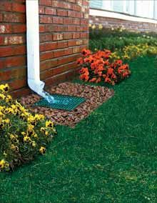 After – Placing a yard inlet (connected to a perforated drainage pipe) in puddle-prone areas draws the waste water away, letting the grass recover health and appearance.