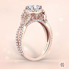 This is so perfect! Loving the bow design, incredible detail on the setting, and flawless rose gold. Kirk Kara engagement ring from the Pirouetta collection | Cushion halo engagement ring | Design K174C65R