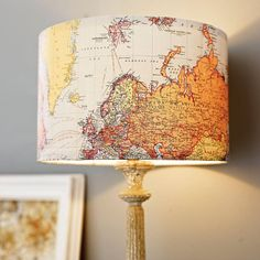 DIY home decorating - Modge Podge a map onto a cheap lampshade. Love this!