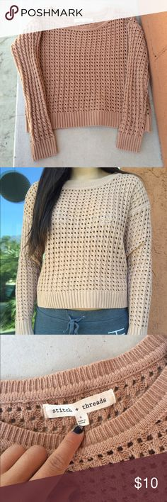 Tan Cutout Sweater Tan/orange sweater with a bunch of square cutouts, 1st picture shows the color of the sweater the best. Only worn once, no flaws Tilly's Sweaters