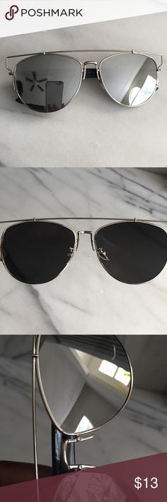 Silver Mirrored Lens Cat Eye Aviator Sunglasses Good used condition. There are a few tiny, and barely noticeable scratches on the front of the lenses that do not affect visibility. I've tried to capture them in the 4th & 5th pictures but it is difficult due to the reflective mirror lens. Accessories Sunglasses
