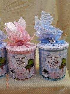 latas de nescau ou leite ninho pintadas com tinta especial, com r´tulos personalizados e tampa coberta com tecido, fazemos tbm outros temas