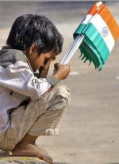 A little boy selling Indian flags