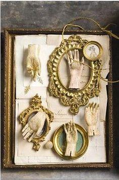 Hands, frames, ephemera:  so much to fondle.