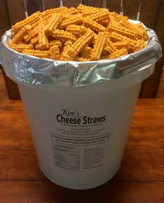 Kim's Cheese Straws by the Bucket- $150 for 8 lbs (128 ozs or approximately 1,024 straws) of fresh homemade cheese straws packaged in a 5 gallon bucket. Great to serve at weddings and parties or to package in smaller sizes for favors or gifts. They are cooked to order so are super fresh when you receive them. They are sealed in an air tight mylar food bag inside a 5 gallon bucket to help protect them during shipment and make them easy to carry to events.