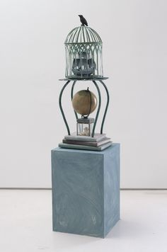 """Betye Saar, """"The Challenges of Fate,"""" 2013. Cage and table on books, 40 x 13 x 13 in. (101.6 x 33 x 33 cm).   Photo: Robert Wedemeyer; courtesy of the artist and Roberts & Tilton, Culver City, California."""