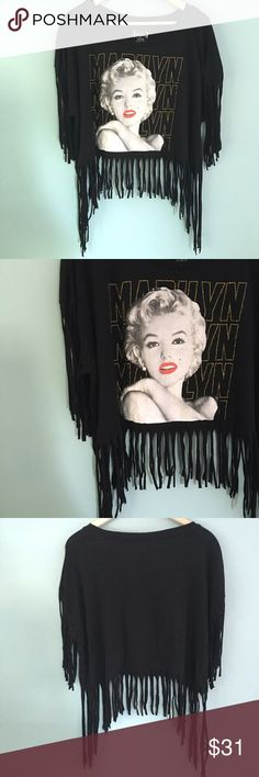"""PlusSz-Marilyn Monroe Fringe Crop Top Plus size Marilyn Monroe Fringe Crop Top for the Marilyn lover! // sz XXL (19) // Hollywood Legends brand // 60% cotton, 40% polyester // could also fit medium, large, or extra-large as an oversized top // black shirt with gold glitter accents // nothing on back // 24.5"""" across armpits laid flat // 17.5"""" length to top of fringe // not my size. Can't model. // non-smoking home // 20% off 3+ Bundles // offers welcome! // Same Day or Next Day Shipping…"""