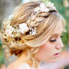 50 Romantic Wedding Hairstyles Using Flowers. Some are a little out there for my taste, but most of them are beautiful! :)