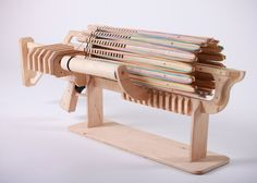 Alex Shpetniy and Brian Dinh have created an awesome rubber band machine gun that is capable of holding 672 shots ready to unload and fires them at roughly a rate of 14 bands a second.