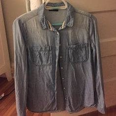 """Urban Outfitters Denim Shirt BDG denim shirt with buttons down the front and pockets on both breasts. Size tag was cut out because it was suuuper itchy but I'm 99% sure it's an XS. I'm 5'2"""" and petite and when I wear it it's a little baggy so I think it'll totally fit a size S as well! Urban Outfitters Tops Button Down Shirts"""
