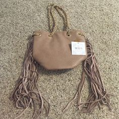 Fringe Purse Tan fringe purse. Never used, perfect condition, comes with tags. Bags Shoulder Bags