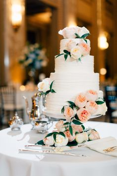 Gorgeous floral topped wedding cake: http://www.stylemepretty.com/missouri-weddings/st-louis/2016/01/25/classic-st-louis-opera-house-wedding/   Photography:  Mike Cassimatis - http://www.mnc-photography.com/