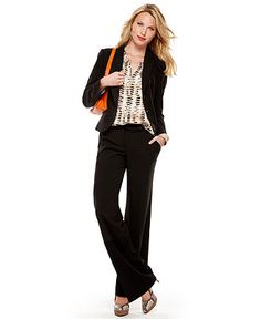 Classic Black Suit. Great look for a traditional presentation, speech, interview, or business meeting. A black pant suit is a great investment piece that will always look professional.  Express your personality by pairing this suit with a patterned top or signature accessories, like the orange purse.  ------------ For more business, marketing, and presentation tips, visit www.HugSpeak.com