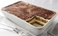 Tiramisu  Serves: 4-6    Ingredients  1 cup whipping cream   1 cup Mascarpone cheese   2-3 Tbs sugar, to taste   1 tsp vanilla extract   1 Tbs amaretto or rum   1 cup strong cold coffee   about 7 oz (200 g) ladyfingers (savoiardi)   cocoa, for dusting