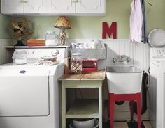 Country laundry room.  Especially love the table and sink area.