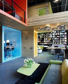 Spaces in spaces. Love the colors, contrast, light and the tolomeo lamps. Book shelf is awesome. Modern + Retro