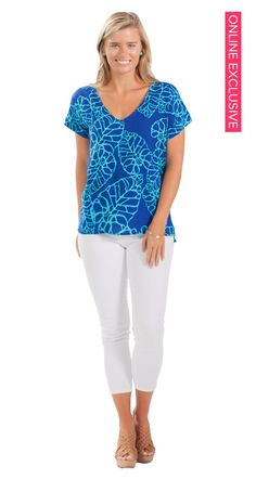 You can't go wrong with a classic V-neck blouse in a vibrant, beachy print!