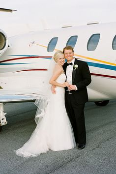 A great photo for a jet-setting couple | Melissa Schollaert Photography | Brides.com