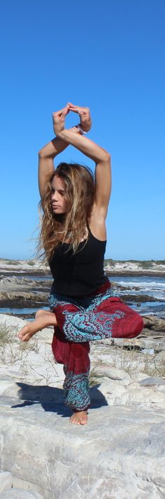 Asha @the_travelling_yogi_ in Fire and Ice Honey Hive harem pants enjoying a gorgeous beach in south africa and catching up on some energy inducing yoga!