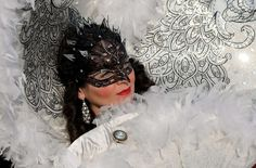 """A costumed reveler poses at St Mark's square (Piazza San marco) during the Venice Carnival on February 8, 2015 in Venice. The 2015 edition of the Venice carnival is """"The world's most delicious festival"""" and runs until February 17th. (VINCENZO PINTO/AFP/Getty Images)"""