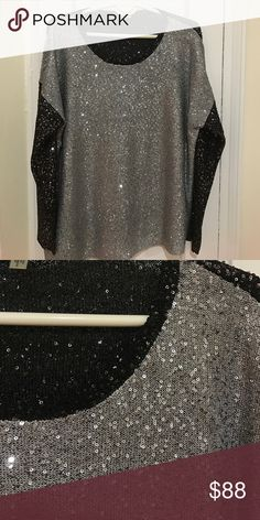 Sequin Sweater Silver & black asymmetric bottom sweater. Back is all sequin also. DKNY Sweaters