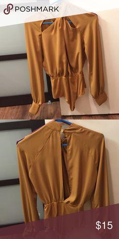 mustard halter cutout bodysuit Gorgeous never worn. New. So flattering and elegant Forever 21 Tops Blouses