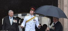 Harry emerges into the rain with Australian War Memorial chairman Ken Doolan (left) and Go...