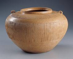 Chinese Jar with Ribbed Decoration, 4th century B.C. probably Zhejiang province, Warring States period (475–221 B.C.); Stoneware with yellowish green glaze; Kimbell Art Museum Antique Stoneware, Antique Pottery, Earthenware, Ceramic Pottery, Pottery Art, Ceramic Art, Pottery Ideas, Chinese Arts And Crafts, Zhou Dynasty