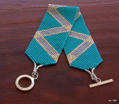 Beaded Bracelet - Beadwork Statement Bracelet - Peyote Beaded Handmade Bracelet - Beadwork statement bracelet in a simple in design yet so wearable. Turquoise, lavender and a sprinkling of silver will make a bold statement. Finished with a simple silver plated toggle closure.  Sizing..............this piece measures 6 3/4 long by 1 wide  For custom items please provide your wrist measurement and whether you prefer a loose or tight fit.  To view other pieces in our collection http:/&...