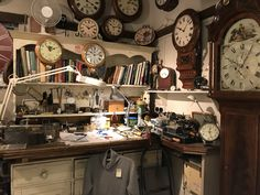 Watchmakers workbench in Bosham, England. Notice the beautiful lathe in the right. Another on the left.