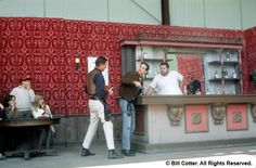 Hollywood, U.S.A. Guests could get right in the middle of simulated filming. Here a bemused family watches a pair of stuntmen begin a bar fight