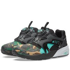 Delving into the jungle after the sun goes down, Puma deliver the Disc Blaze silhouette in collaboration with Japanese sneaker retailer atmos. The 'Night Jungle' serves to complement the bold, laceless and multi-layered construction of the shoe as a camo print is found on the suede toe, with hints of emerald green on the PUMA stripe.  Multi-Layered Uppers Camo Suede Toe Laceless Disc Design Textured Rubber Outsole