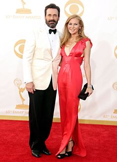 The Mad Men star Jon Hamm, in Armani, and his wife Jennifer Westfeldt , in a low-cut red gown, Amrapali jewelry, and Stuart Weitzman shoes, looked gorgeous on the Emmys 2013 red carpet.