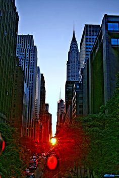 https://flic.kr/p/6sHeBC | Manhattanhenge | Also known as the Manhattan Solstice, Manhattanhenge occurs biannually when the setting sun is aligned with the east-west grid of Manhattan streets.