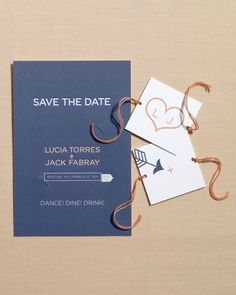 Just like a Cracker Jack box, this stationery comes with its own tiny toy: a spinner that reflects the playfulness of your relationship. When guests twist the strings and pull, it creates an image of a heart that's been pierced by Cupid's arrow.