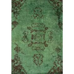 Over-dyed woven rug.     Product: RugConstruction Material: 100% ViscoseColor: GreenFeatures:  Machine wovenMade in TurkeyTribal motif Note: Please be aware that actual colors may vary from those shown on your screen. Accent rugs may also not show the entire pattern that the corresponding area rugs have.Cleaning and Care: Spot treat with a mild detergent and water.  Professional cleaning is recommended if necessary.