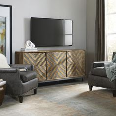 A metal chevron inlay dresses up the Hooker Furniture Serramonte 69 in. Entertainment/Accent Console , making it a chic addition to any living space.