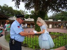 Check out this security guard at Walt Disney World that asks pint-sized Princesses for their autographs, making them feel like royalty!