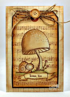 monochromatic card in browns with a mushroom, cute snail,purple onion stamps, music background, twine and a button