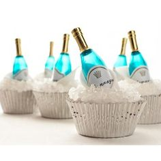 Champagne Bottle Cupcakes Cakegirls- I'm not big into the cupcake craze, but this is a neat idea.