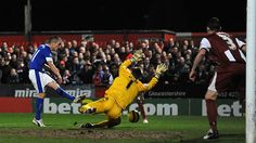 7 January 2012 Leon Osman takes a pass from Leighton Baines before drifting past a Cheltenham defender and scoring Everton's third against Cheltenham