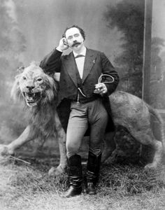 ca. 1870// lion is definitely stuffed, a prop, don't know if he is a lion tamer in real life.