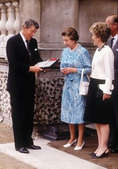 Queen Elizabeth II and U.S. Presidents Past and Present---Queen Elizabeth II presents President Ronald Reagan with an honorary knighthood, June 14, 1989, at Buckingham Palace in London. Reagan was the first U.S. President in more than 35 years to be knighted by the Queen of England. Only Republican presidents have received this honor. Looking on are Prince Phillip and first lady Nancy Reagan. (David Levenson/Getty Images)