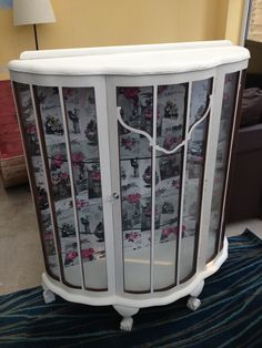 pretty vintage display cabinet painted in Annie Sloane Old White with vintage paper to the back, ball and claw feet, glass bow fronted
