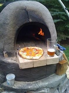Cob Oven - food time!    we could totally build one of these!